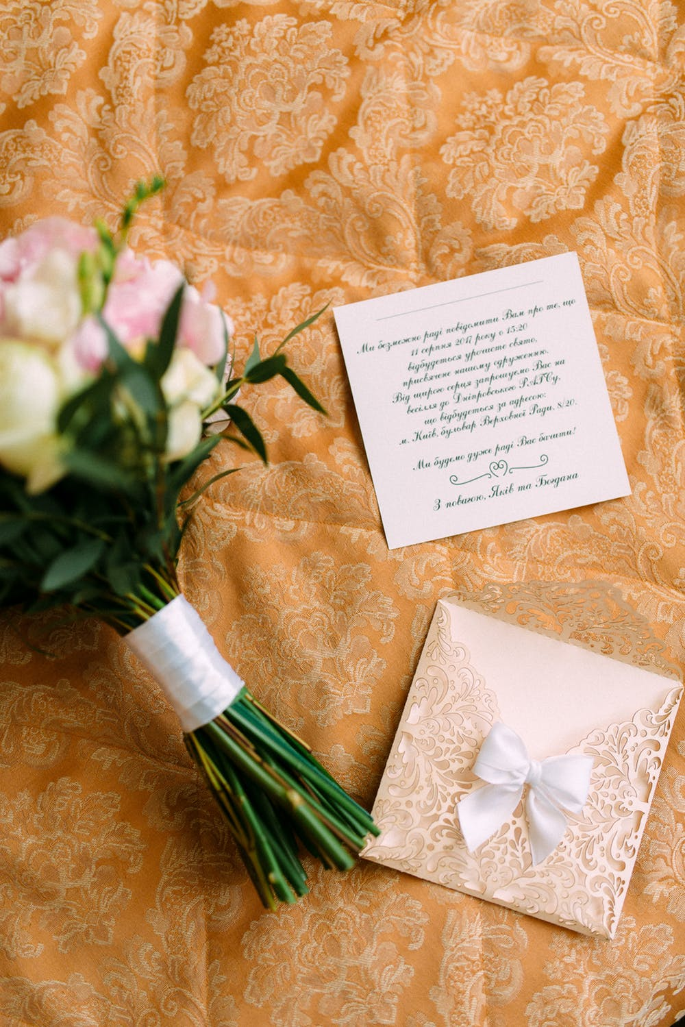 wedding card and a bouquet of flower